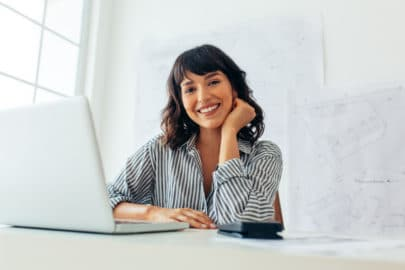 Office worker smiling using Microsoft Teams | BC Networks